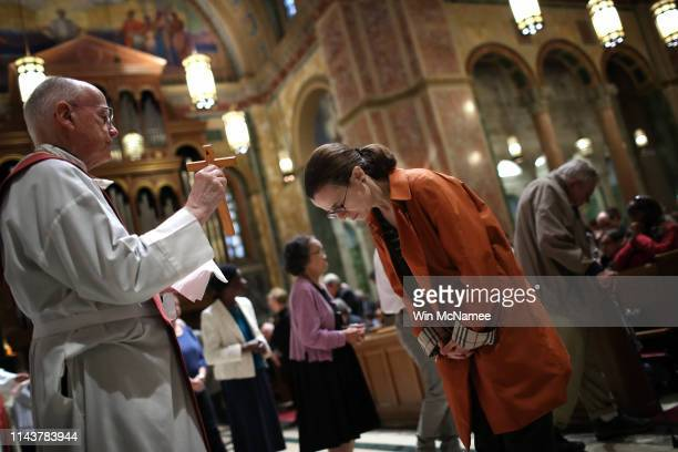 Catholics attend Good Friday services at St Matthew's Cathedral April 19 2019 in Washington DC Christians around the world marked Good Friday today...
