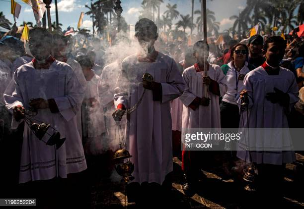 Catholics attend the arrival of the image of the Virgin of Fatima from Portugal in Managua on January 25 2020
