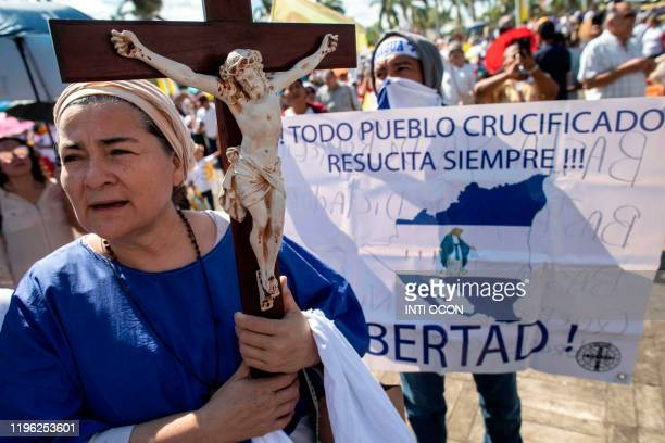 Catholics attend the arrival of the image of the Virgin of Fatima from Portugal to the Cathedral in Managua on January 25 2020