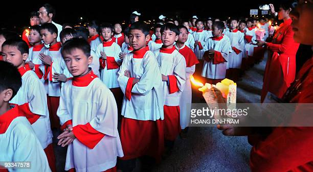 Catholics boys march in procession as they take part in the opening ceremony of the Holy Year celebrations at So Kien church in the northern province...