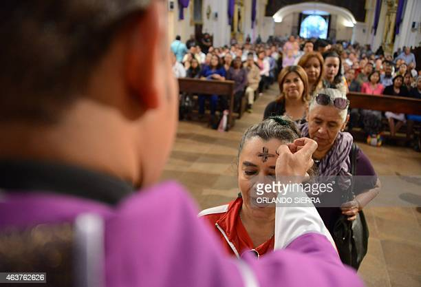 Catholics celebrate Ash Wednesday marking the beginning of Lent a period of penitence for Christians before Easter in Tegucigalpa Honduras on...
