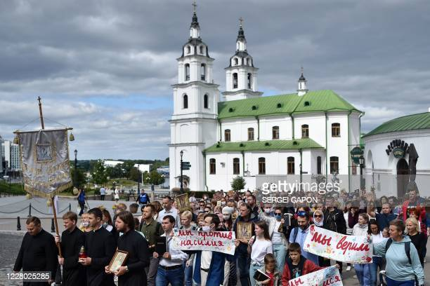 Catholics evangelicals and Orthodox believers take part in a religious procession on the fifth day of protests over Belarus' disputed presidential...