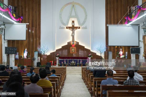 Catholics from nearby villages pray and chant in Bobei Catholic Church in Guangdong province China on the morning of March 4 2018