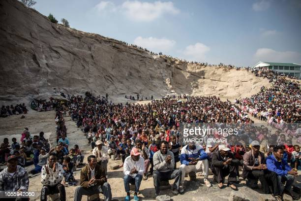 Catholics gather at a quarry in the Akamasoa district of Antananarivo on November 1 as they celebrate an All Saints Day mass Akamasoa is the district...