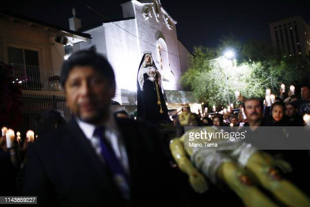 Catholics gather for a Good Friday 'Way of the Cross' procession on April 19 2019 in Los Angeles California The traditional Catholic procession...