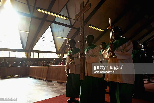 Catholics gather to celebrate mass at the Regina Mundi Catholic Church in Soweto Township June 23 2013 in Johannesburg South Africa The church played...