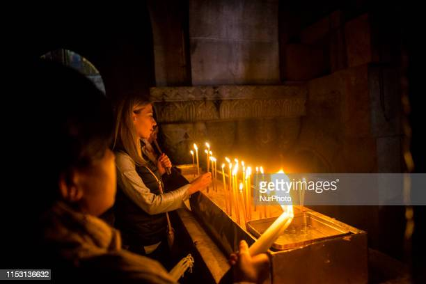 Catholics light candles in the church of Holy Sepulcre in the oldi city of Jerusalem Isrel on 23 February 2018