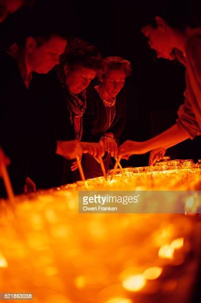 Catholics Lighting Candles on Christmas