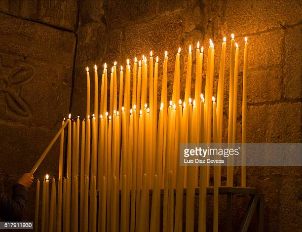catholics lighting candles - osterfeuer stock-fotos und bilder
