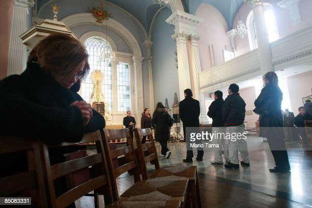Catholics line up to receive ashes during Ash Wednesday celebrations at St Paul's Chapel February 25 2009 in New York City The historic chapel where...
