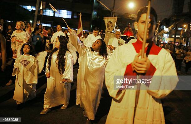 Catholics march in a procession honoring Saint Rita the patron saint of the impossible on May 25 2014 in Rio de Janeiro Brazil Brazil holds more...