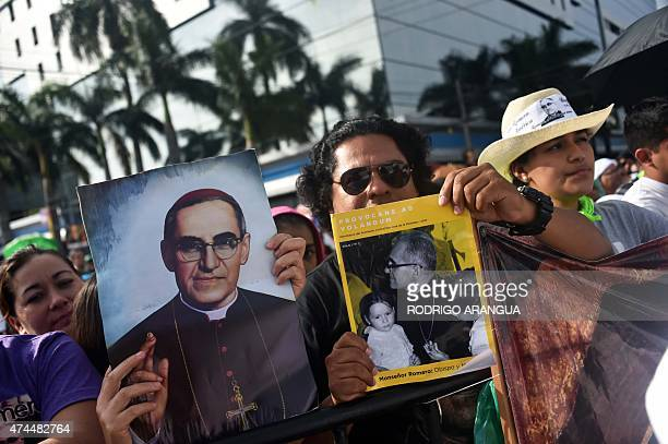 Catholics participate in a mass celebrating the beatification of Salvadorean archbishop Oscar Romero at the Salvador del Mundo square in San Salvador...