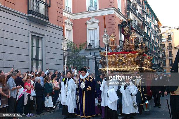 Catholics pray as they walk during the silence procession of Maundy Thursday in Madrid Spain on April 18 2014 Easter is a festival and holiday...