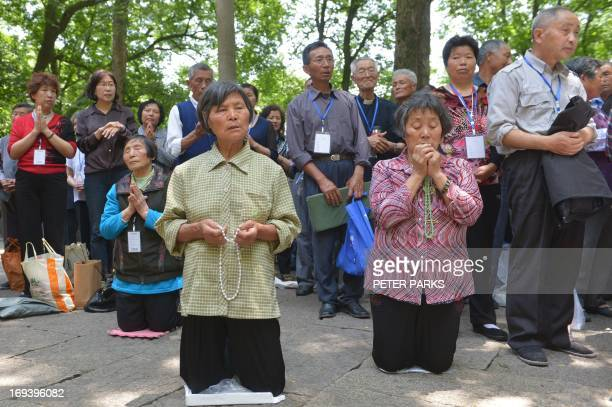 Catholics pray at Our Lady of Sheshan Basilica Catholic church in Shanghai on May 24, 2013. Pope Francis called on Chinese Catholics to affirm their...