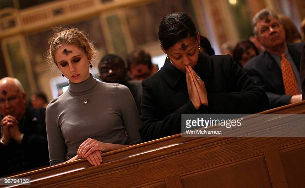 Catholics pray during an Ash Wednesday Mass at the Cathedral of Saint Matthew the Apostle February 17 2010 in Washington DC Today marks the beginning...
