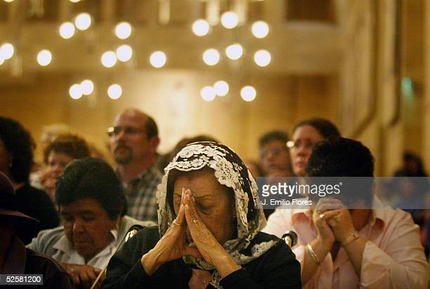 Catholics pray during an evening Mass at Our Lady of Angels cathedral April 2 2005 in Los Angeles California