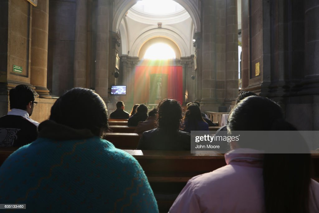 Catholics pray during Mass at a cathedral on February 12, 2017 in Quetzaltenango, Guatemala. The Catholic Church has been losing membership in Guatemala in recent years with the explosive growth of Evangelical Protestant faiths.