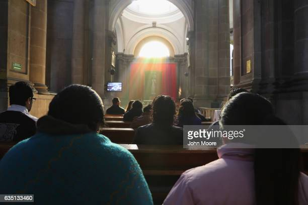 Catholics pray during Mass at a cathedral on February 12 2017 in Quetzaltenango Guatemala The Catholic Church has been losing membership in Guatemala...