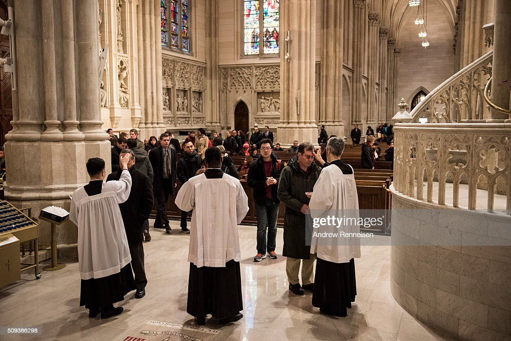 Catholics receive ashes on Ash Wednesday at St. Patrick's Cathedral on February 10, 2016 in New York City. The day marks the start of the lent for Catholics world wide.