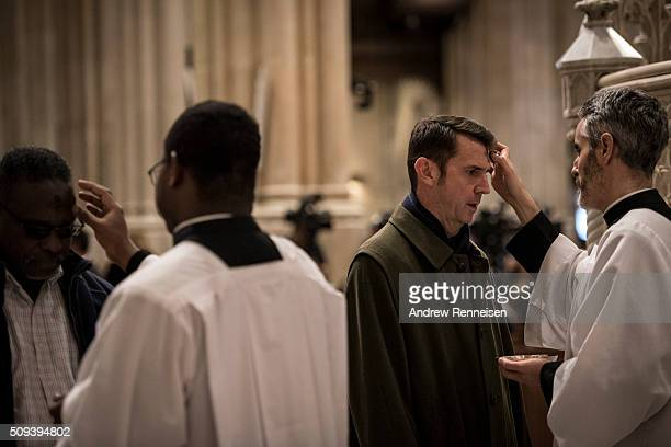 Catholics receive ashes on Ash Wednesday at St Patrick's Cathedral on February 10 2016 in New York City The day marks the start of the lent for...