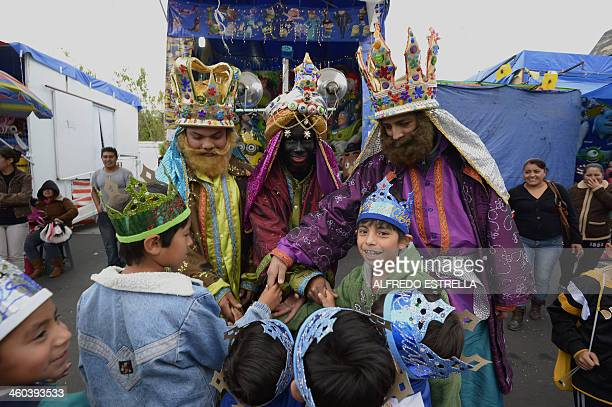 Catholics representing the Three Wise Men greet children at Mexico City's Buenavista neighbourhood before a walk around the capital on January 3 2014...