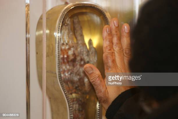 Catholics venerate the forearm of Saint Francis Xavier, a popular saint revered by Catholics worldwide, at St. Michael's Cathedral Basilica in...