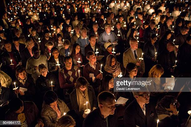 Catholics with lighted candles in the congregation at the Easter Vigil service in Westminster Cathedral on the evening of Holy Saturday April 19 2014...