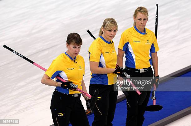 Cathrine Lindahl Eva Lund and Anna Le Moine of Sweden look on during the women's curling round robin game against Denmark on day 5 of the Vancouver...