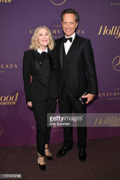 Cathrine O'Hara and Richard E. Grant attend The Hollywood Reporter 2019 Oscar Nominee Party at CUT on February 04, 2019 in Beverly Hills, California.