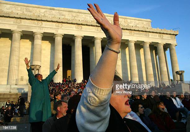 Cathy Alphin of Springfield Virginia worships with members of the congregation during an annual sunrise service to celebrate Easter April 20 2003 at...