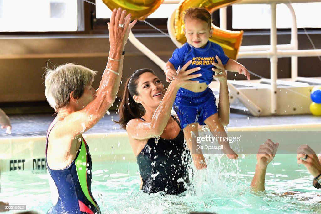 Cathy Bennett, Nicole Phelps and Boomer Phelps attend the Huggies Little Swimmers #trainingfor2032 Swim Class With The Phelps Foundation on August 21, 2017 in New York City.
