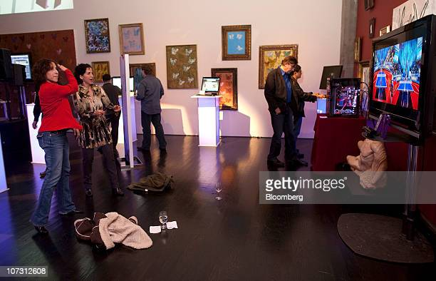 Cathy Brooks left and Shirin Papillon play table tennis using Microsoft Corp Kinect for Xbox 360 at a Microsoft event in San Francisco California US...
