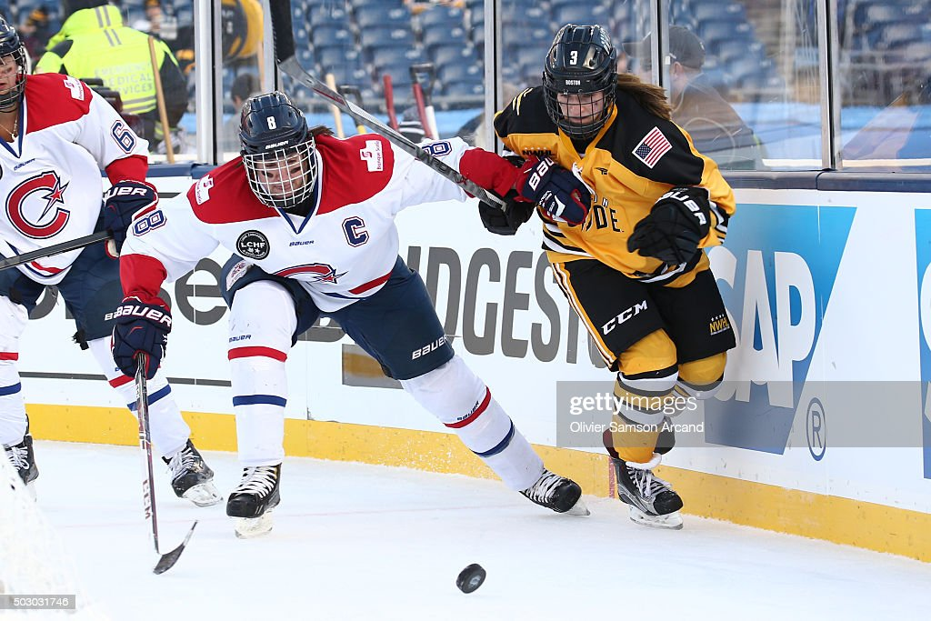 Cathy Chartland #8 of the Les Canadiennes fights for the puck against Jillian Dempsey #3 of the Boston Pride in the Women's Hockey Classic on December 31, 2015 during 2016 Bridgestone NHL Winter Classic at Gillette Stadium in Foxboro, Massachusetts.