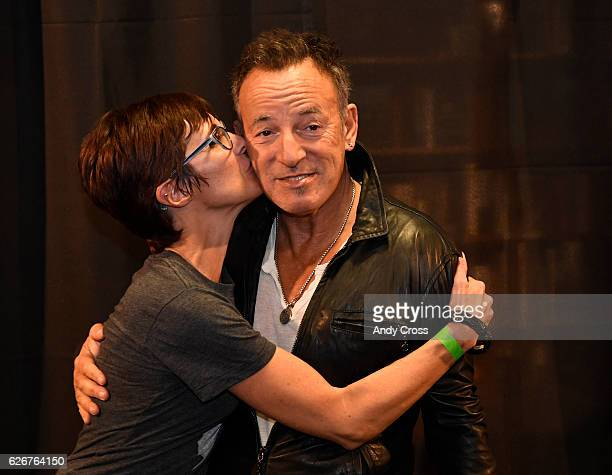 Cathy Esposito gives super rocker Bruce Springsteen at kiss on the cheek at the Tattered Cover book store on E Colfax November 30 2016 Over a...