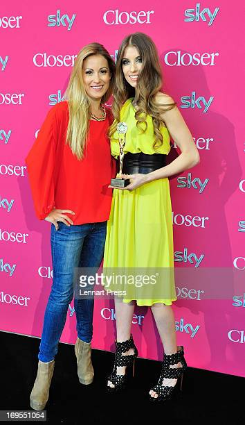 Cathy Fischer girlfriend of Dortmund's defender Mats Hummels and pesenter Andrea Kaiser pose with the award during the 'Beliebteste SpielerFrau...