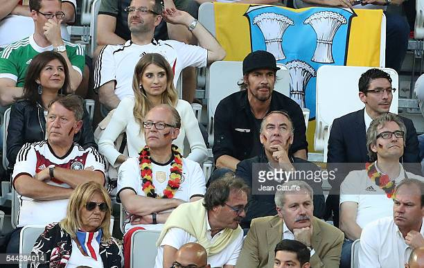 Cathy Fischer wife of Mats Hummels of Germany and Thomas Hayo attend the UEFA Euro 2016 quarter final match between Germany and Italy at Stade Matmut...
