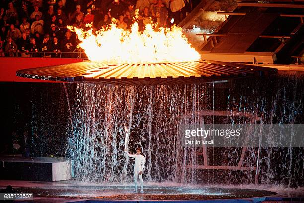 Cathy Freeman an aboriginal Australian athlete lights the Olympic torch during the opening ceremony for the 2000 Olympic Games