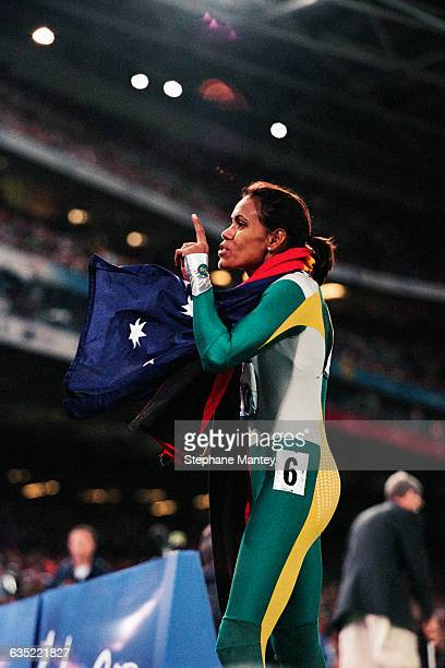 Cathy Freeman from Australia celebrates after winning the women's 400meter sprint of the 2000 Olympics