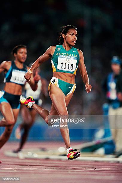Cathy Freeman from Australia competes in a women's 400meter heat at the 2000 Olympics