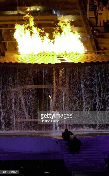 Cathy Freeman holds the Olympic torch after just having lit the Olympic cauldron that rose up around her at the opening ceremonies for the XXVII...