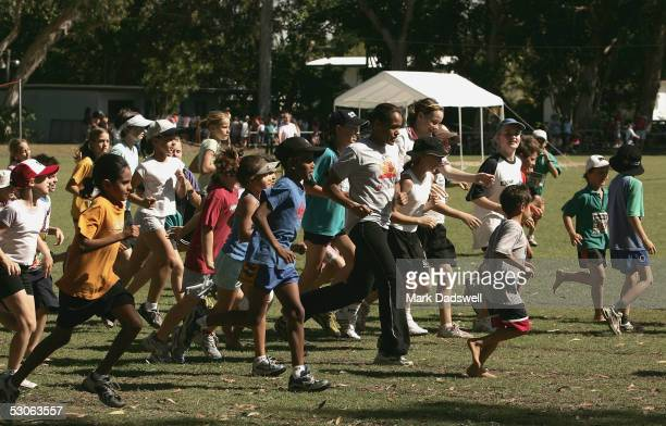 Cathy Freeman jogs a cool down lap with participants during the Athletics For Remote and Rural centres run by Athletics Australia at the Cathy...