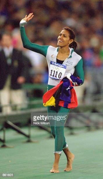 Cathy Freeman of Australia celebrates her win for gold in the Womens 400m Final at the Olympic Stadium September 25 2000 on Day Ten of the 2000...