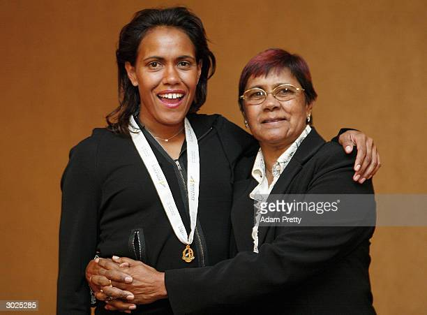 Cathy Freeman of Australia celebrates with her mother after winning the Edwin Flack award during the Telstra Athlete of the year dinner at the...