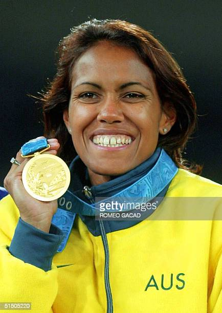 Cathy Freeman of Australia is all smiles as she displays her gold medal after winning the women's 400m final 25 September 2000 at the Sydney Olympic...