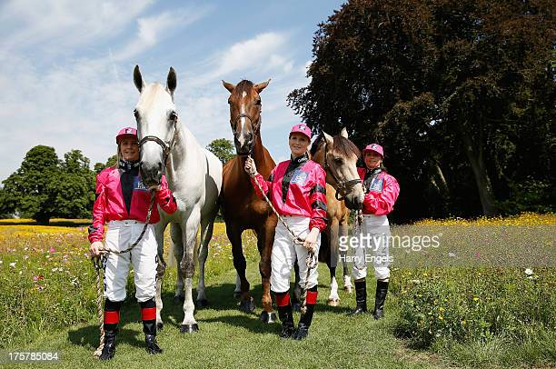 Cathy Gannon from Ireland Rosie Napravnik from the USA and Lisa Allpress from New Zealand riding for 'The Girls Team' pose for a photograph during a...