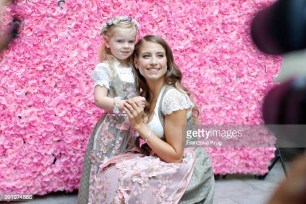 Cathy Hummels and child model Olivia pose at the Cathy Hummels by Angermaier collection presentation at Titanic Hotel on July 5 2018 in Berlin Germany