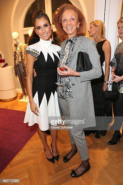 Cathy Hummels and Marina Meggle during the Talbot Runhof flagship boutique opening at Preysing Palais on October 14 2015 in Munich Germany