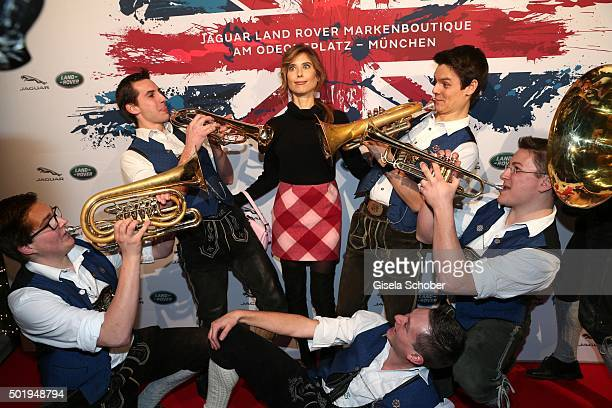 Cathy Hummels and the band Tromposaund during the opening of the Jaguar Land Rover Boutique on December 18 2015 in Munich Germany