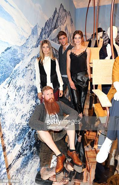 Cathy Hummels Model George Alsford Model Milly Simmonds and Franz Keilhofer during the KONEN fall/winter season opening on August 31 2016 in Munich...