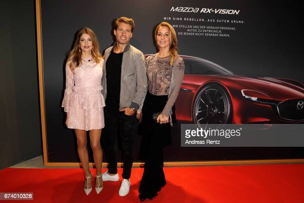 Cathy Hummels, Raul Richter and Charlotte Wuerdig attend the spring cocktail hosted by Mazda and InTouch magazine at Mazda Pop Up-Store on April 27,...